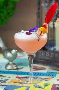 """A Peck 'em cocktail at The Happenstance. Explain that """"a little bird told you"""" about a secret drink, and you'll be served a gin cocktail made with pink grapefruit juice..."""