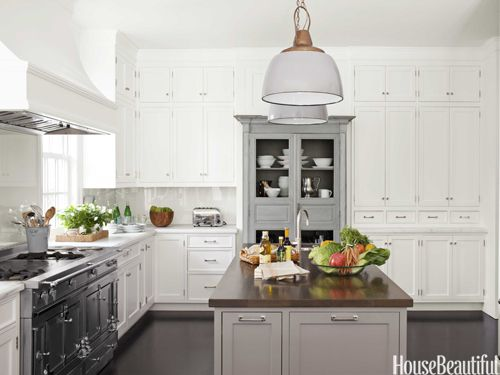 To the ceiling cabinetry + gray island + pendants + walnut
