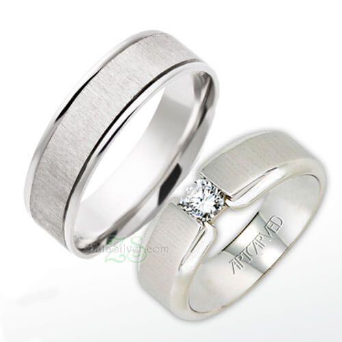 cincin kawin elan model cincin kawin simple unik dengan sebuah permata bulat pada wanita serta