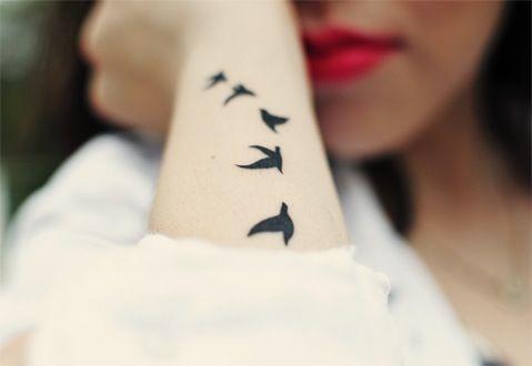 Arm tattoo of birds