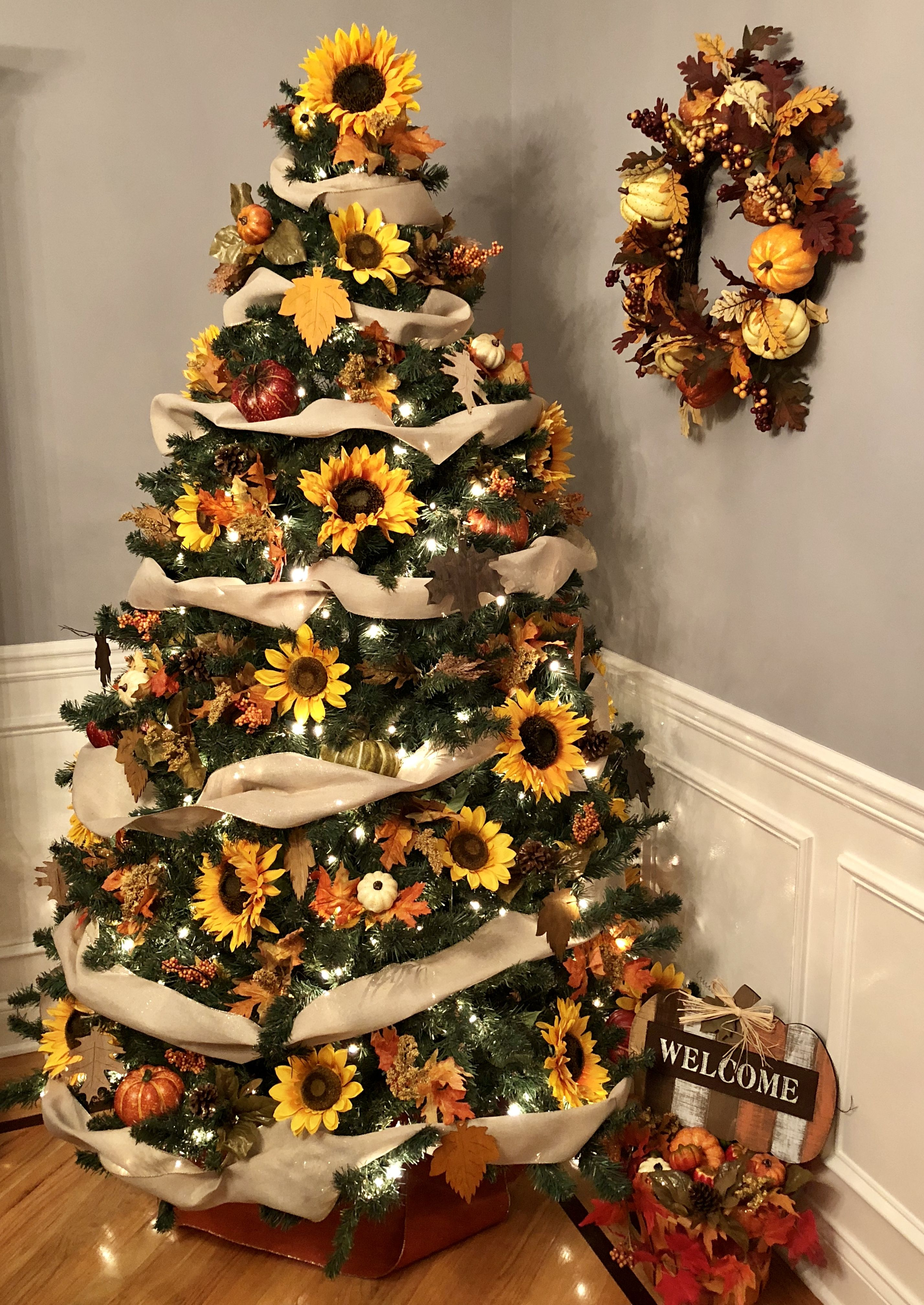 Christmas tree decorated with sunflowers, fall leaves