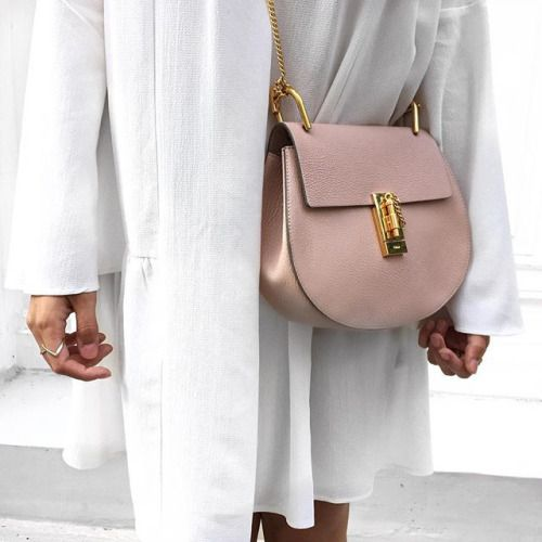 We are loving this white coat paired with a pink Chloé Drew bag. #shopstyle