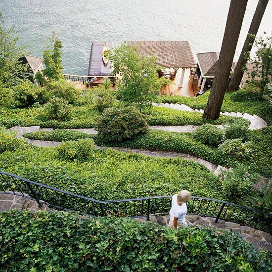 A hillside garden relies on uncomplicated plants.  A switchback path makes quick work of a steep hillside and helps reduce erosion.