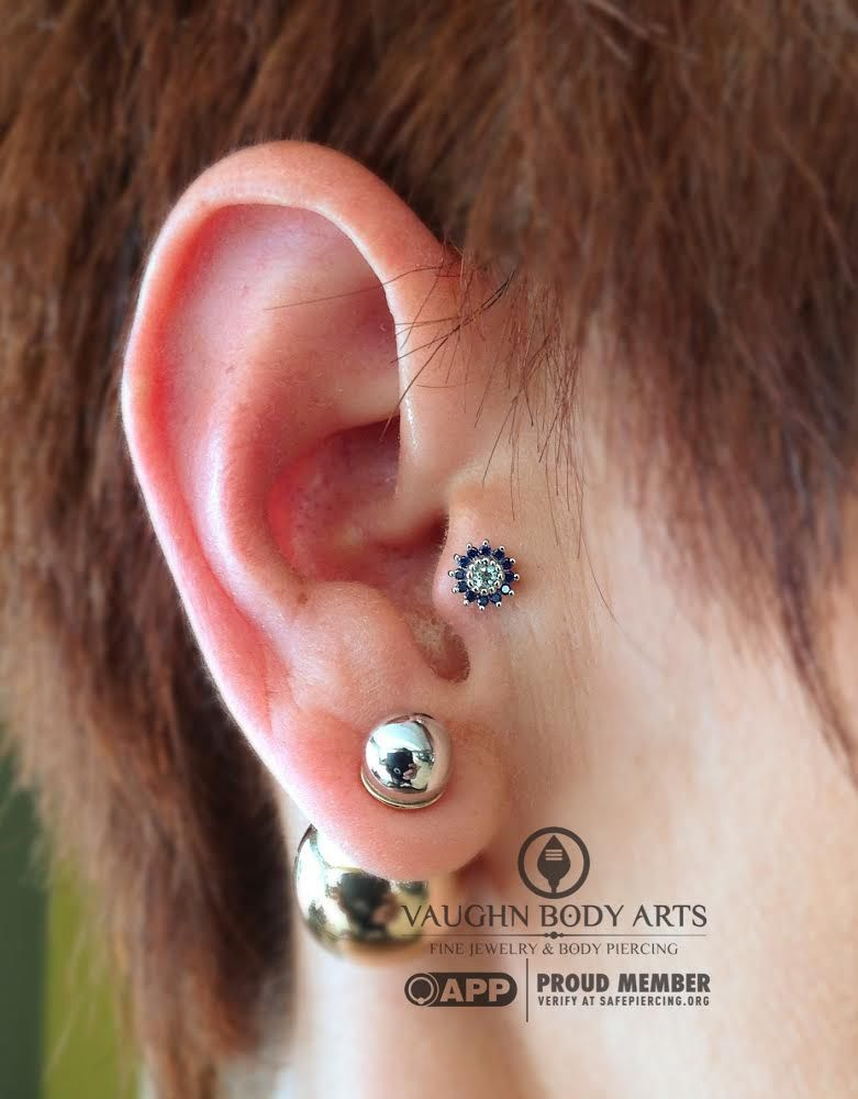 Tragus piercing by Cody Vaughn of Vaughn Body Arts. Jewelry by BVLA.
