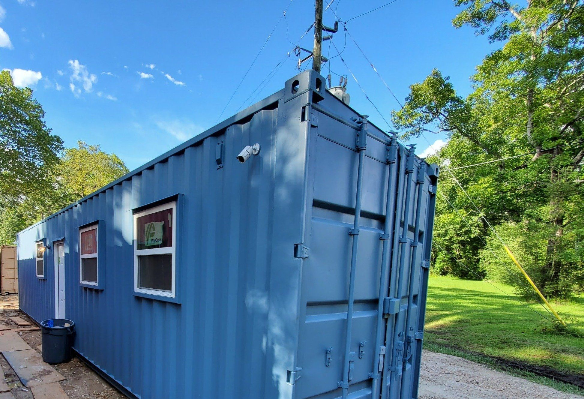 Photo of 40 ft Container Home – The Birch Model – Panel / 40 ft Deck w/ Stairs / Solar Only