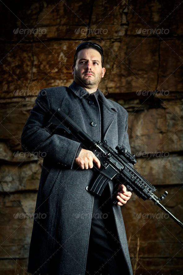 contract killer agent character ...  adult, agent, attitude, black, caucasian, character, contract, cool, criminal, cruel, danger, dark, death, evil, fear, gangster, gun, jacket, killer, long, machine, mafia, male, menace, outdoor, path, pose, quarry, rocks, stance, stone, vegetation, violence