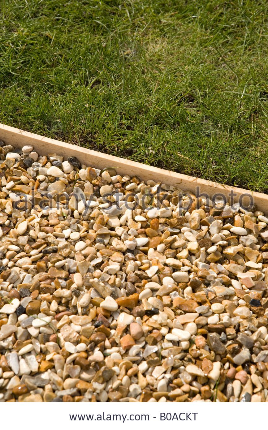 How to make a garden path with gravel - Garden Edging With Wood Gravel Path With Wooden Lawn Edging Stock Photo Picture And