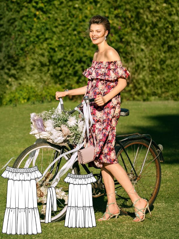 Perfect for cheerful garden and outdoor weddings. This feminine off the shoulder dress has a smocked neckline. The width can be drawn in with an optional fabric belt. The length is particularly flattering for petite women.