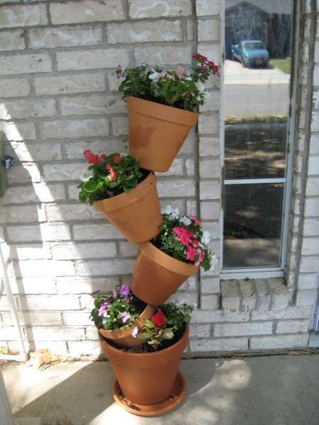 Tip Top Flower Pots Maximize Limited Space To Grow Plants And Flowers Stacked Flower Pots Flower Pots Vertical Garden Diy