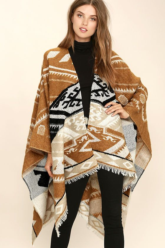 You're sure to win any style showdown when you've got a sharp shooter like the Eastwood Light Brown Southwest Print Poncho! Soft poly-wool blend, decorated with light brown, white, and black southwest print, shapes a roomy bodice with a draping open front. Pointed hems are trimmed with fringe.