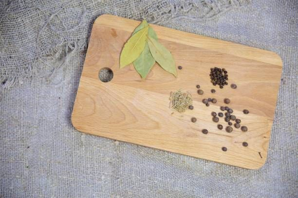 different spices on a wooden board
