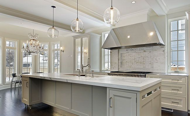 Sparkle And Polished, This Kitchen Utilizes Stainless Steel Appliances And  Sparkling White Marble Countertop