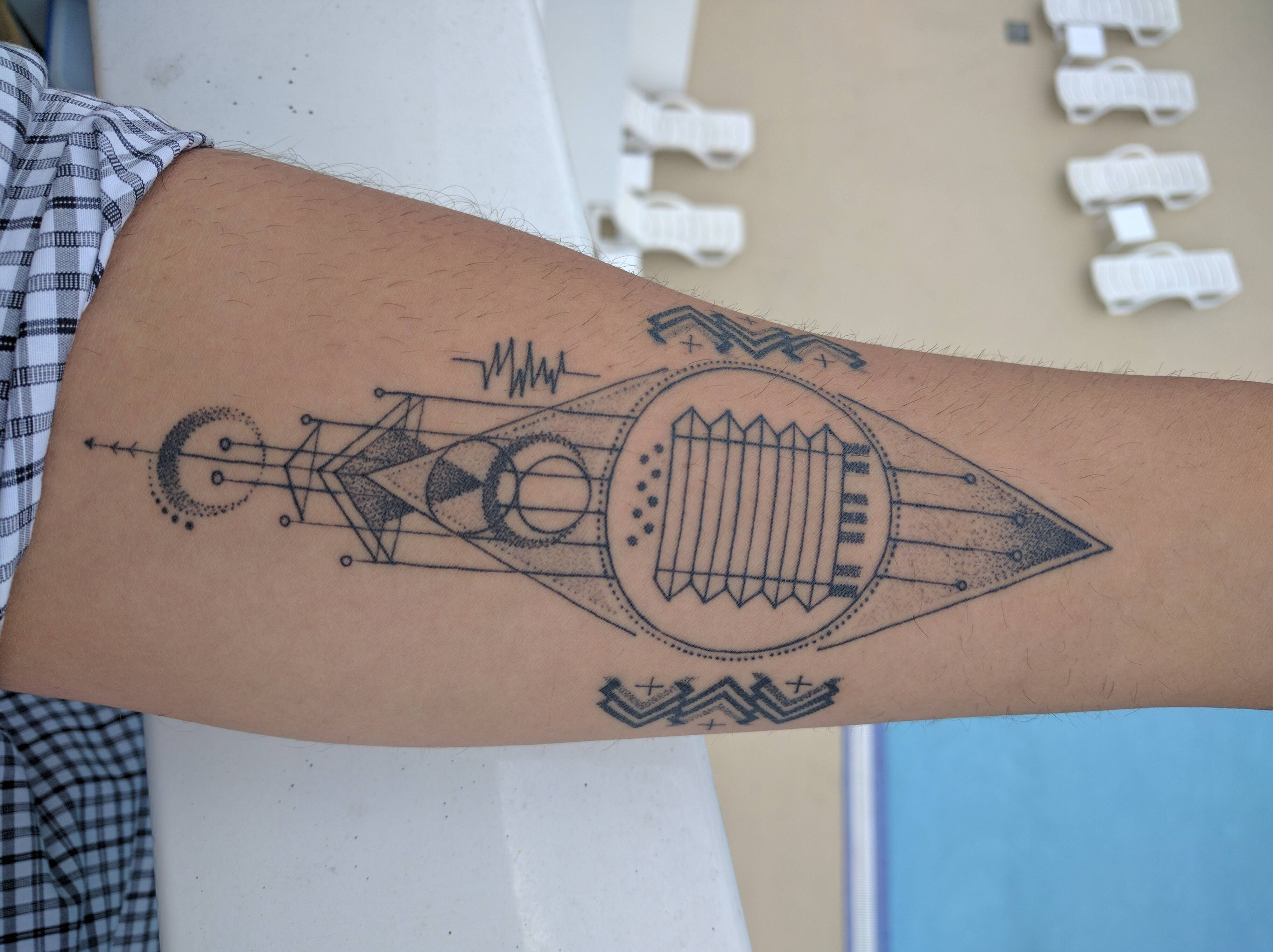 My first tattoo with symbols based on instruments my