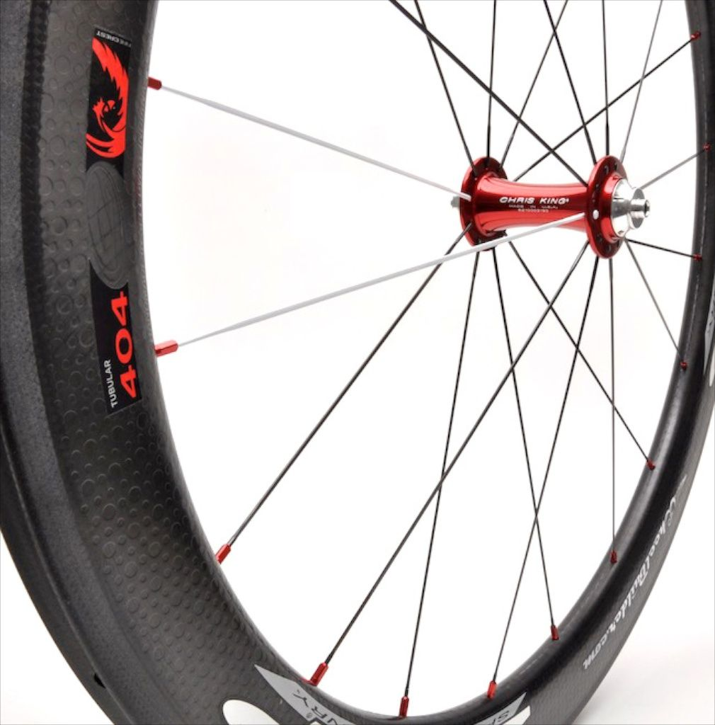 Precision handcrafted zipp 404 firecrest carbon tubular rim with red chris king r45 front hub black white dt swiss aerolite bladed spokes