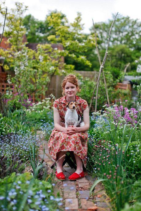 BIRMINGHAM, UK - Alys Fowler, gardener and presenter of BBC's Gardeners' World in her garden with her dog Isabel.
