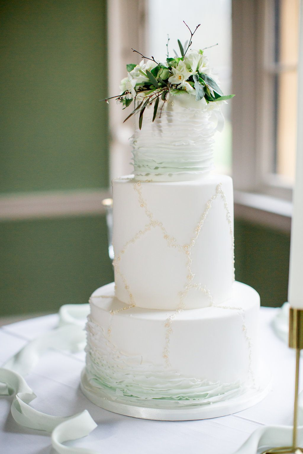 Adding a subtle hint of green into your wedding cake following the