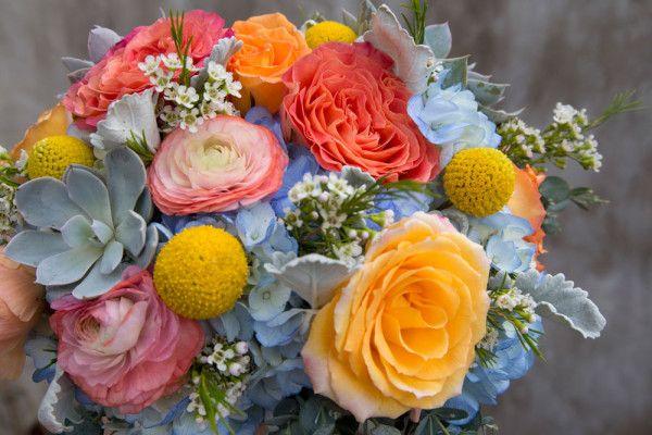 Coral Garden Rose spring bridal bouquet featuring succulents, roses, garden roses