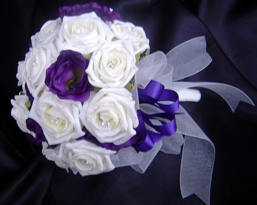 Ivory rose and cadburys purple lisianthus brides bouquet by I Never Thought Of That, via Flickr