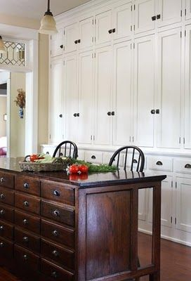 Love the cabinets behind the small island.