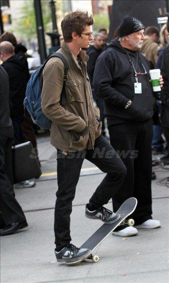 Here's Andrew Garfield as Peter Parker on the set of next summer's Spider-Man reboot flick. Finally a superhero alter ego who sports the humble crud found in an average schmuck's closet (but wears it better than the rest of us): the specs, the boring khaki jacket, the black jeans (you see that, Lauri? black jeans ARE cool...), and some hot-damn-awesome, old-school low-top Nikes.