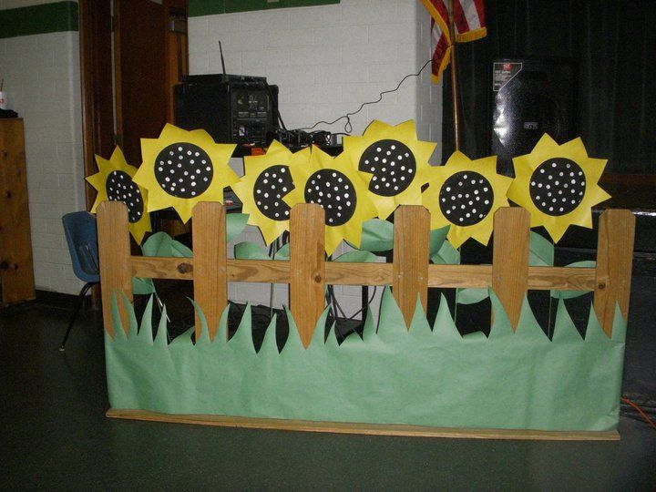 Made the sunflowers out of two paper plates and yellow butcher paper in between.  Used the end of a dowel rod to put dots on the front of them.  Dowel rods were painted green and inserted.