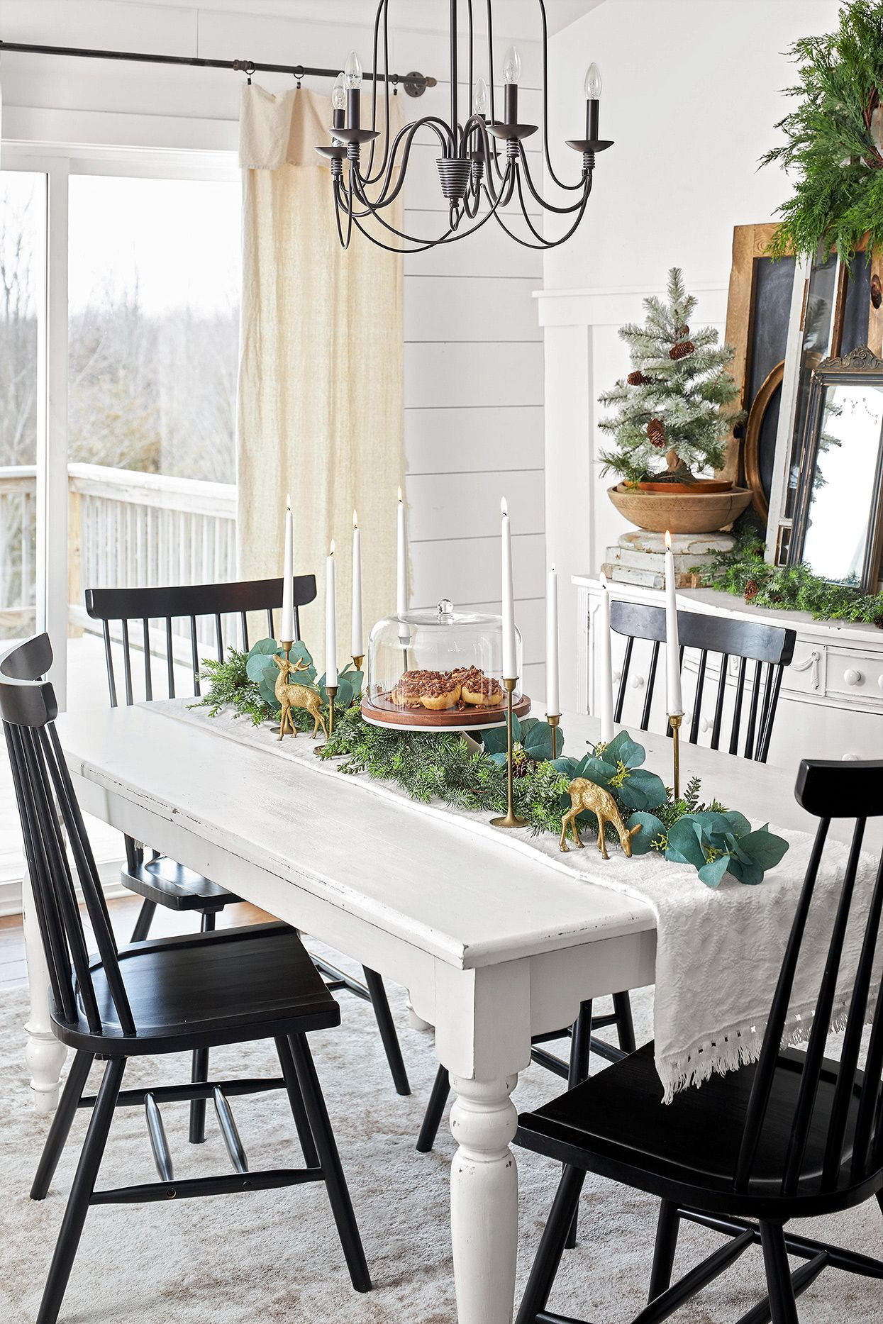 When we decorate with vintage Christmas decor, it transports us to those beloved gatherings of yesteryear. Recreate the memories by shopping antique shops, estate sales, and flea markets for vintage decor that brings wonder and nostalgia back to the holidays. #vintagechristmasdecor #christmasdecorations #holidaydecorideas #nostalgicchristmasdecorations #bhg