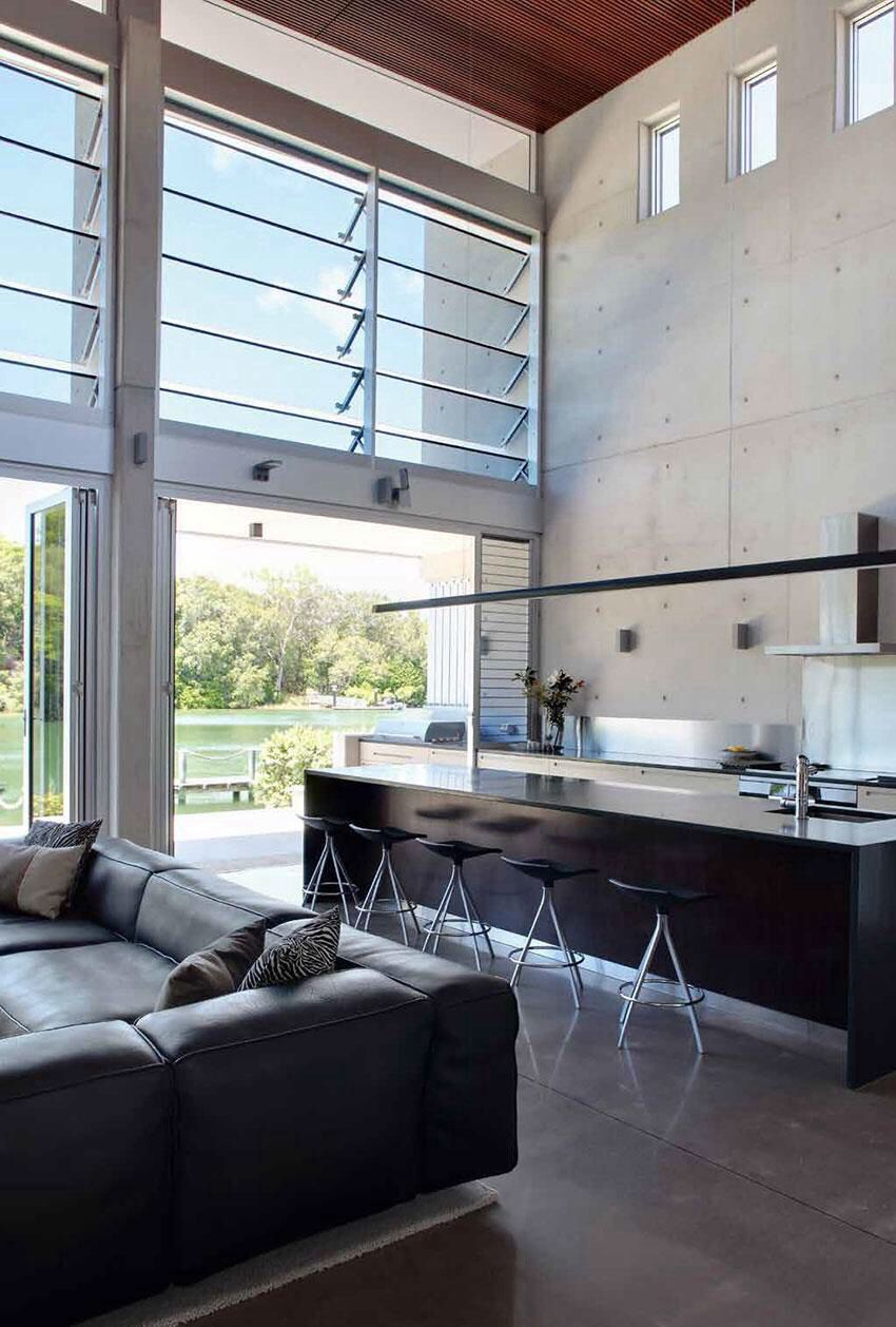 High ceilings, concrete tilt panel walls and polished ...