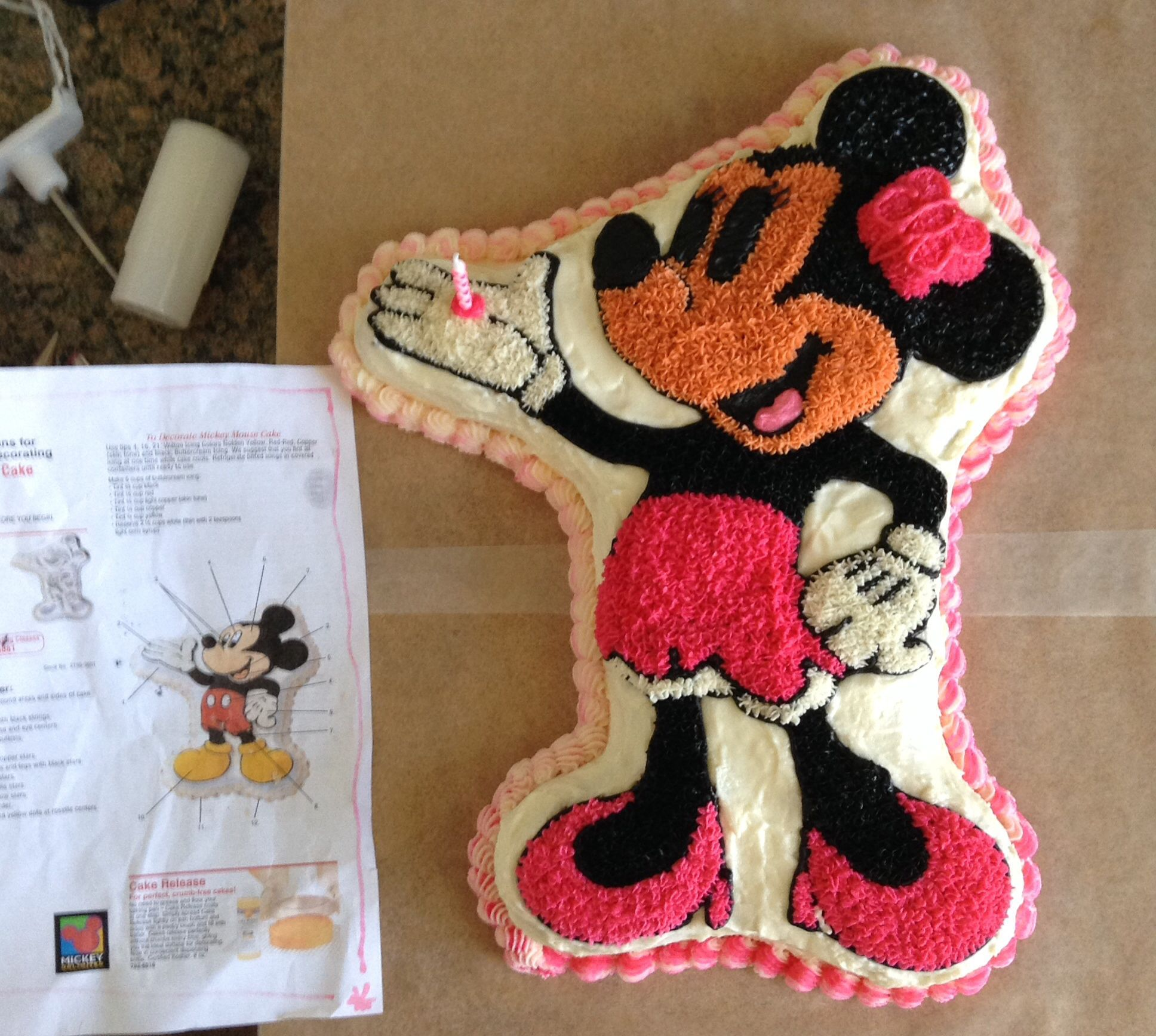 Transformed fullbody wilton mickey mouse cake into minnie