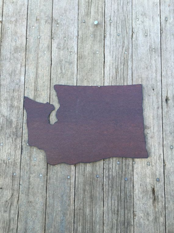 """This state of Washington wall hanging is hand cut from old salvaged tin.  It is sealed with shellac to give it a beautiful sheen to it.  The state measures 14"""" wide and 9"""" tall.      This item is available in 3 different options:      1.  you can purchase just the tin state, no hangers or attached to wood, $20      2.  Attached to a whitewashed distressed 3/4"""" pine board (see picture of state of Texas), $45      3.  Attached to burlap wrapped pine board (see picture of the state of Iowa)…"""