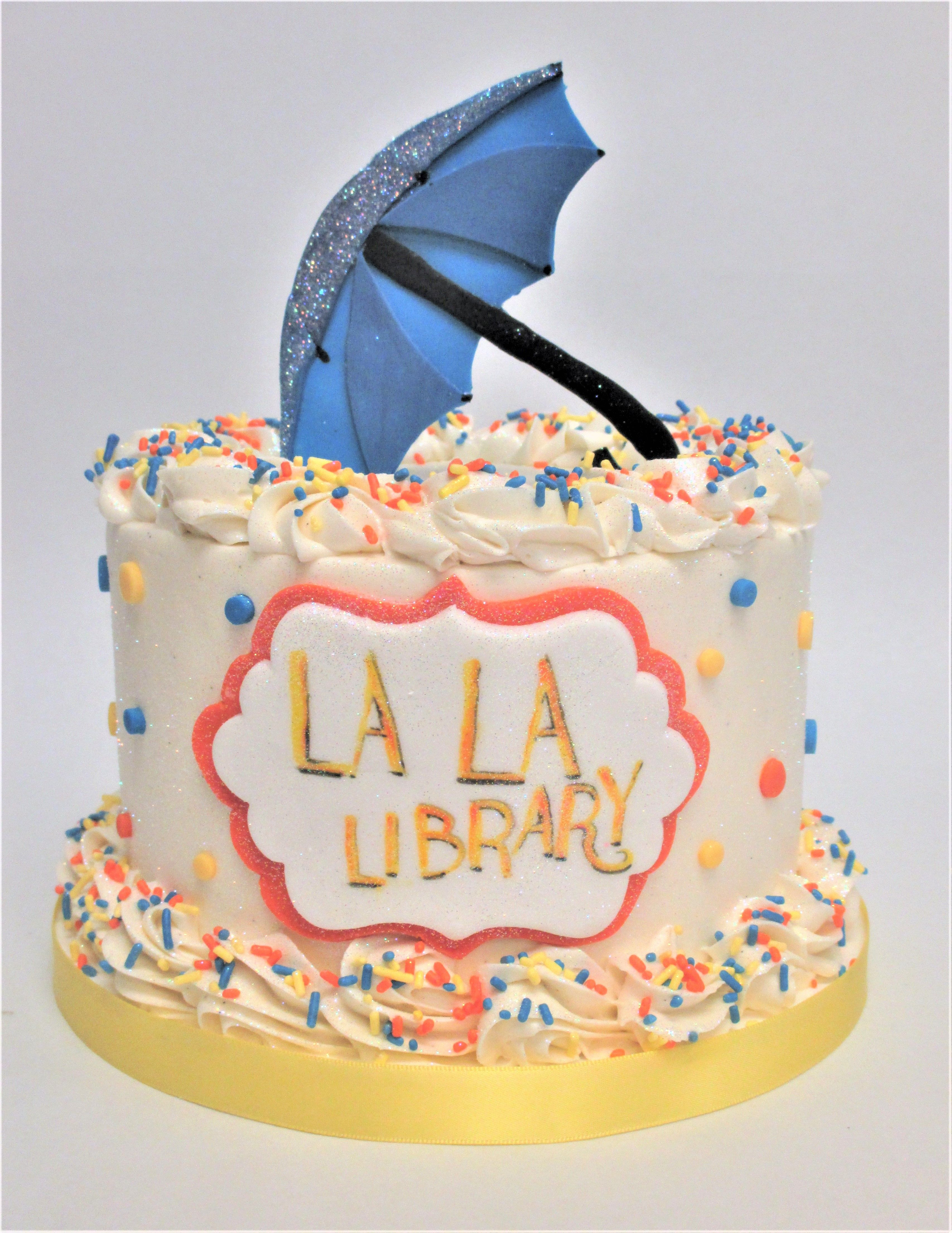 Colorful La La Land Inspired Umbrella Cake by Flavor Cupcakery