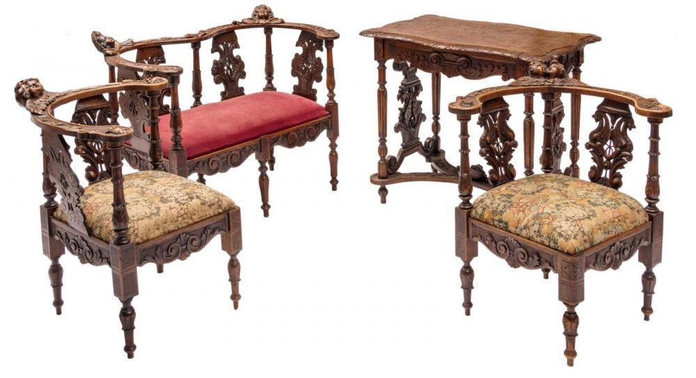 A Historism Italian Baroque Revival Walnut Small Sofa, Two Corner Chairs  And A Table,
