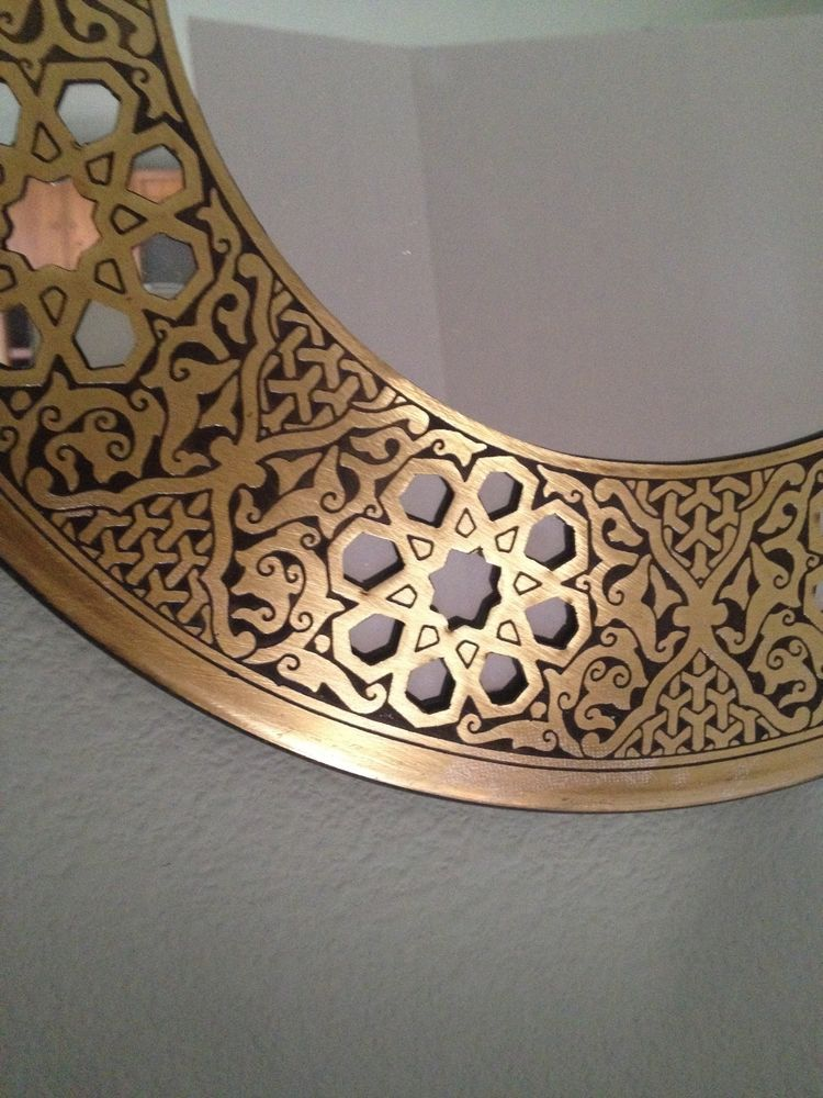 A Circle Mirror With An Arabic Brass Frame Design Wall Hanging