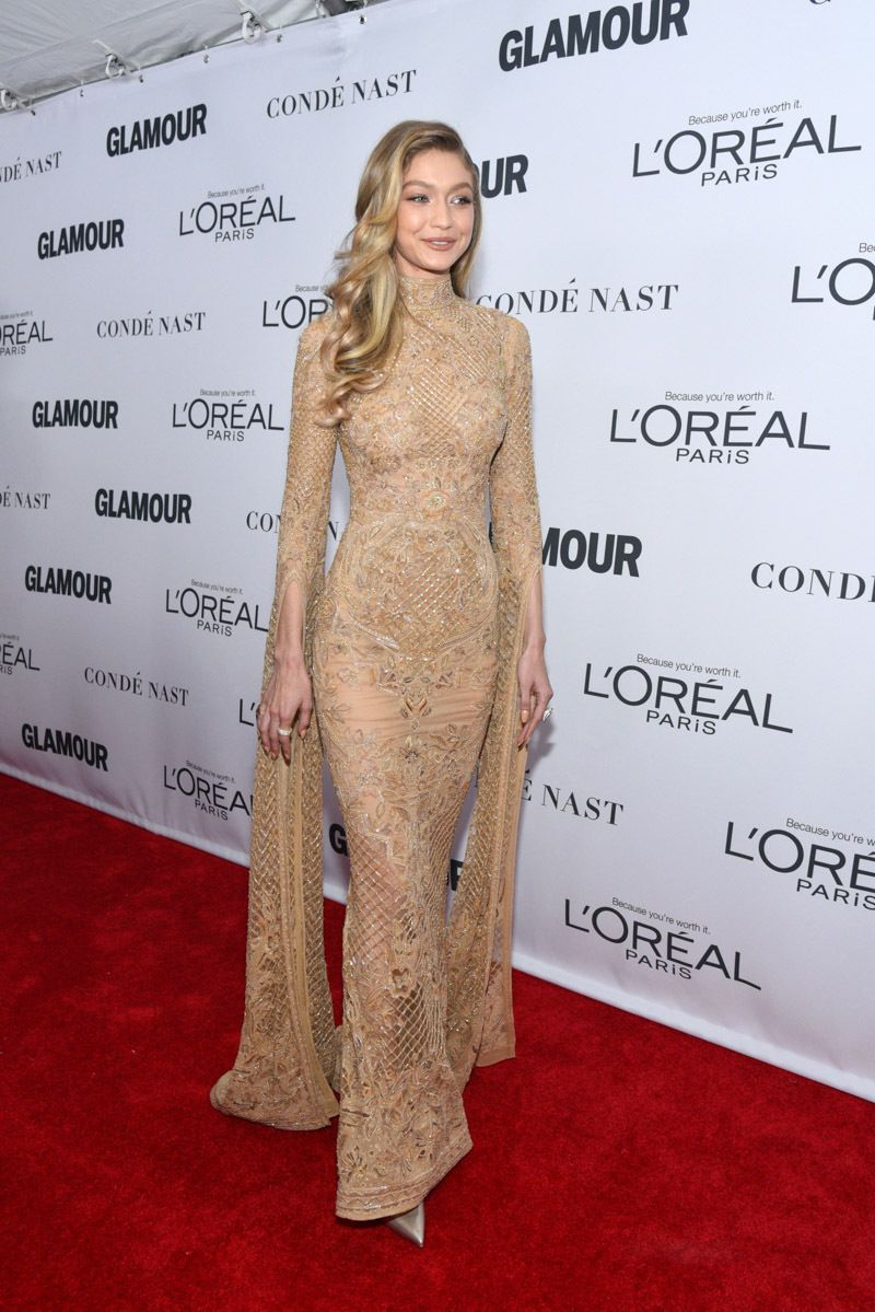 ed769541fc8b Gigi Hadid at Glamour Women of the Year Awards wearing a long-slevved  metallic gown.