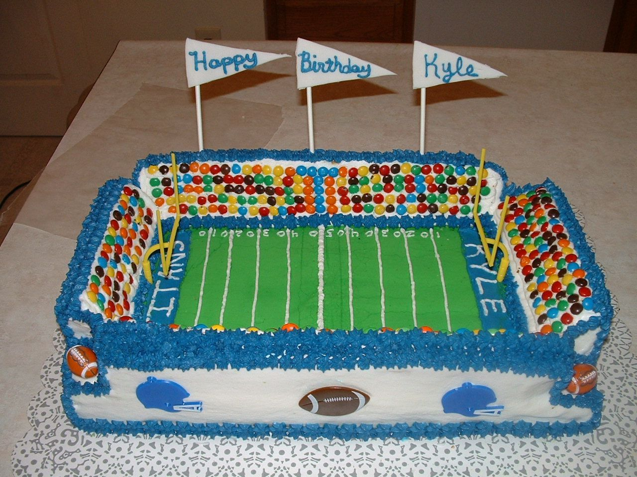- This is a football stadium cake