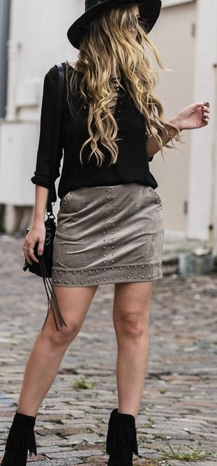 ebb714d3a Spring bohemian outfit styled with lace up top, suede and studded skirt,  and fringe booties