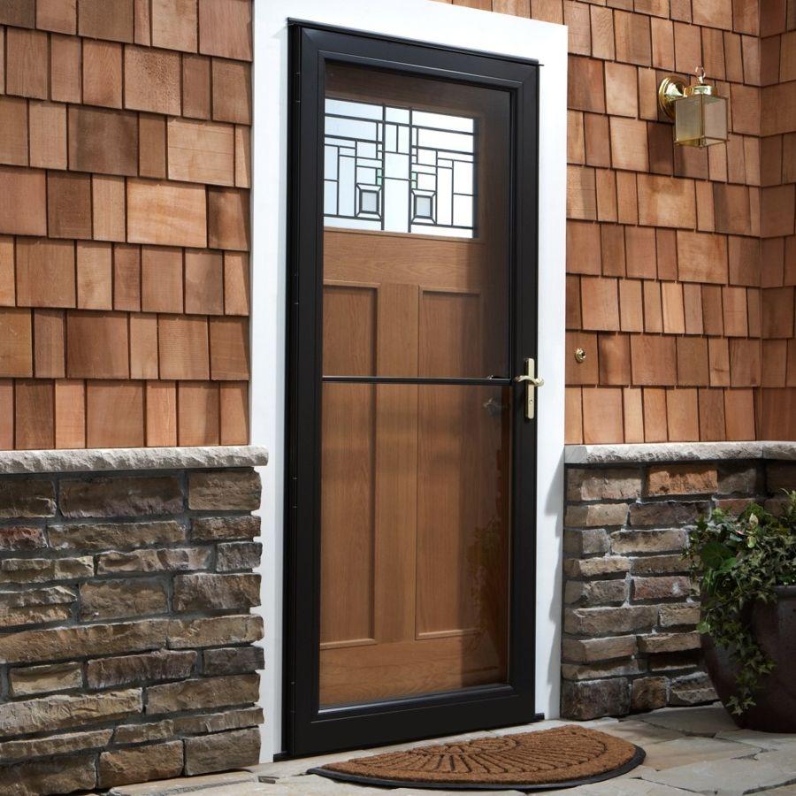 If The Weather Outside Your Door Is Frightful Consider Adding A Storm Door To Your Entryway This Season For A Wood Storm Doors Andersen Storm Doors Storm Door