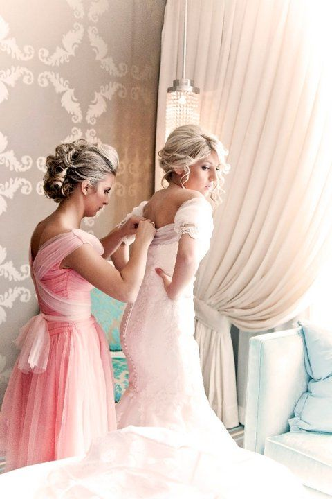what a beautiful picture the wedding dress is gorgeous and the brides maid dress too.