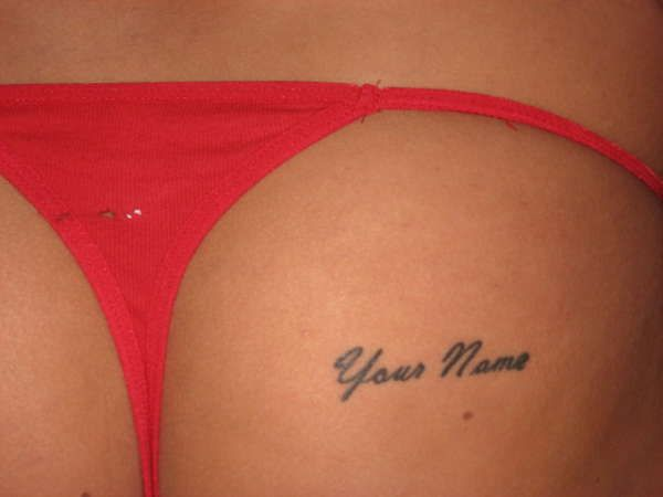 Name tattooed on ass