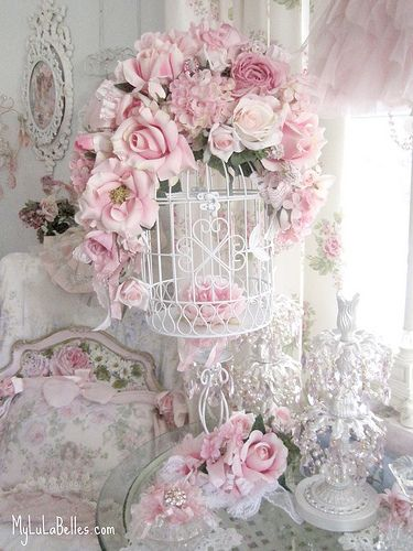Bird cage and flowers ... beautiful!