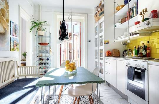 Beautiful, Bright Scandinavian Kitchen with Suspended Lights, Open Shelving, and Yellow Tile Backsplash