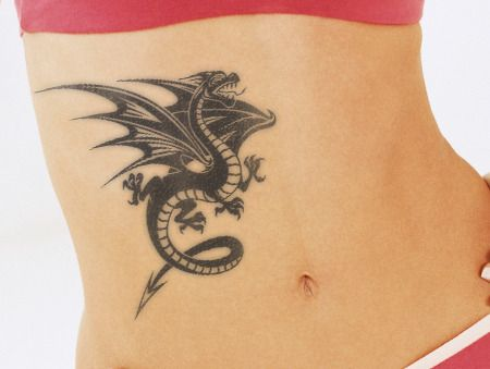 Woman With Dragon Tattoo On Stomach Dragon Tattoo For Women Tattoos For Guys Dragon Tattoos For Men
