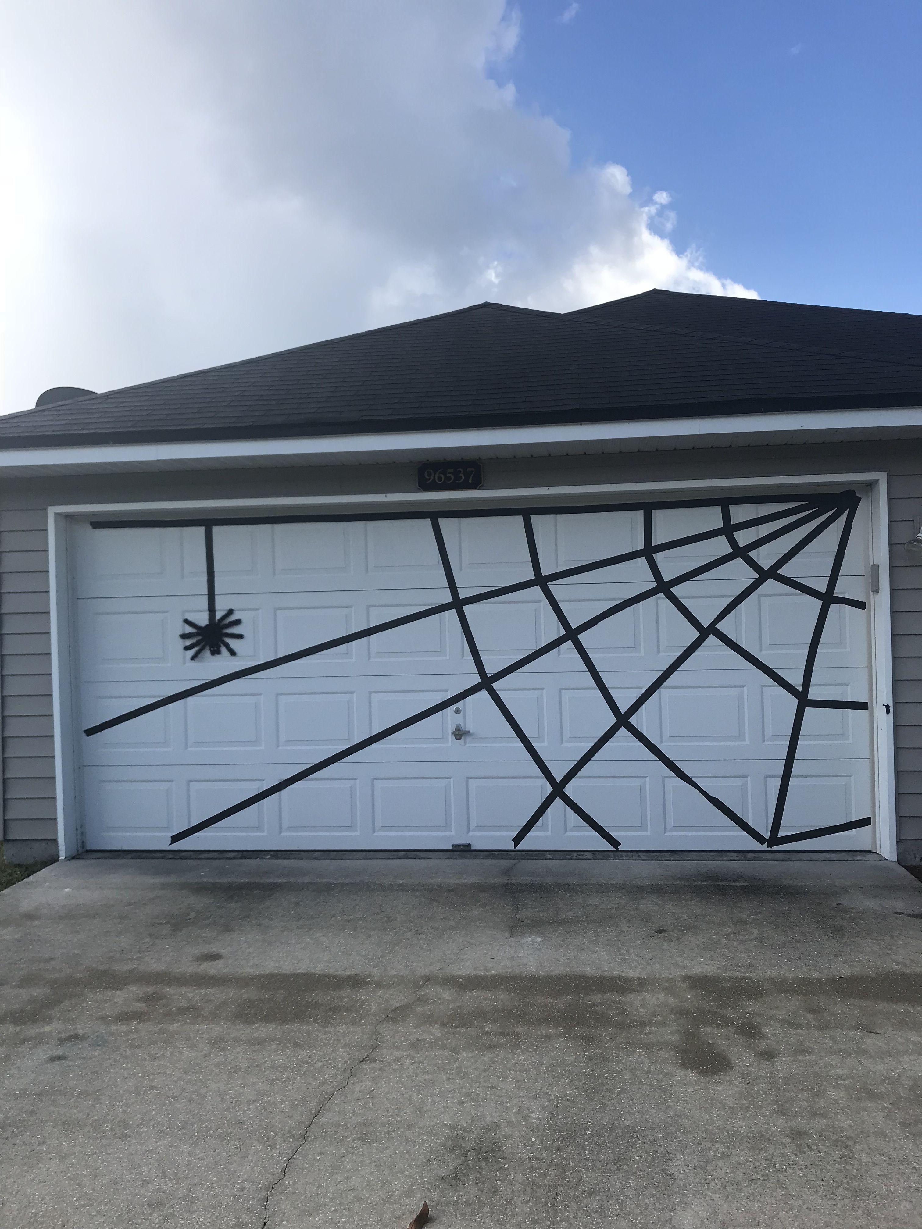 Halloween Garage Door Spider Web Using 2 Inch Black Painters Tape Dollar Tree Halloween Outdoor Decorations Garage Door Halloween Decor Halloween Diy Outdoor