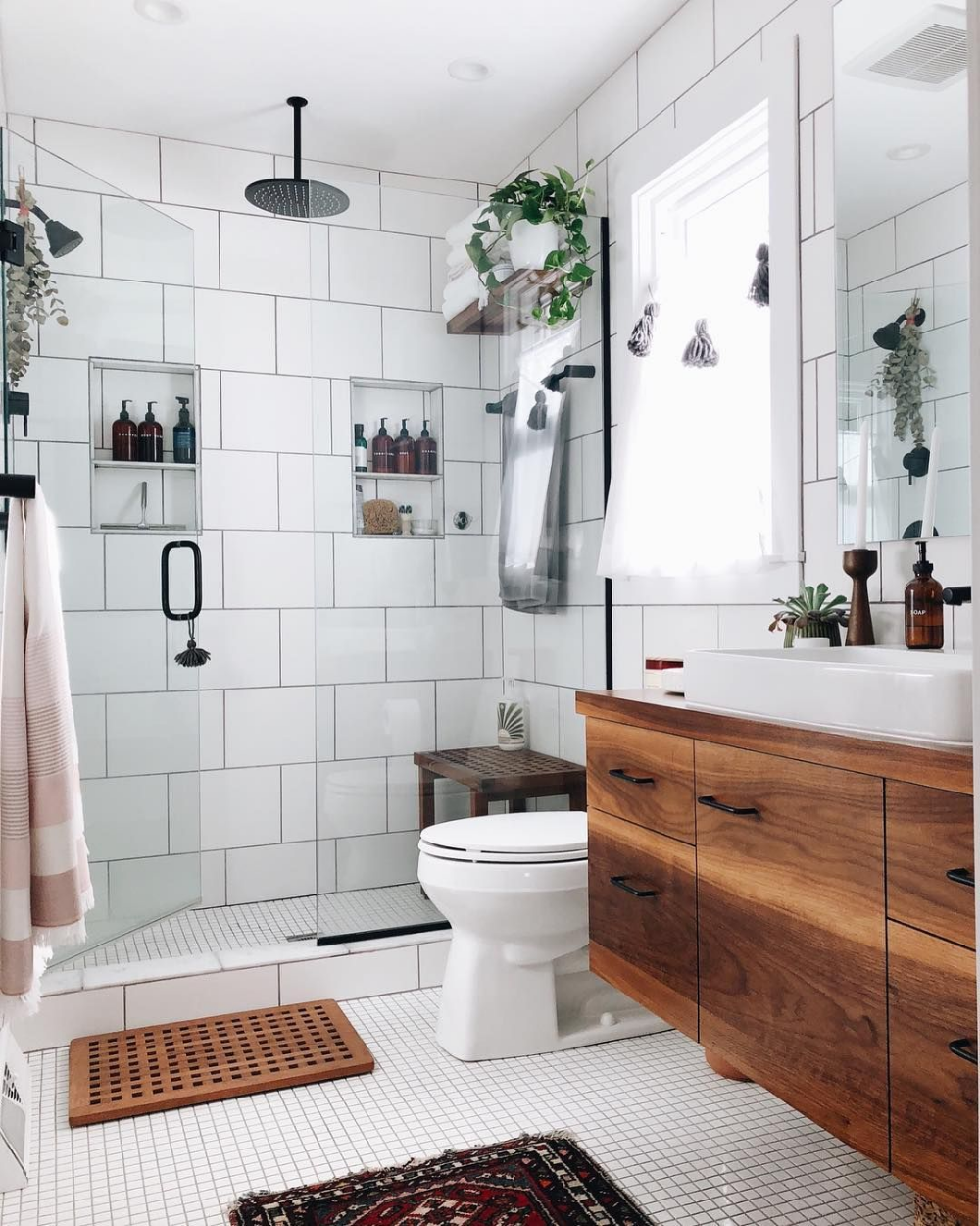 Photo of Bathroom with walk in shower and large white tiles wood cabinets – Home Decorating Trends – Homedit