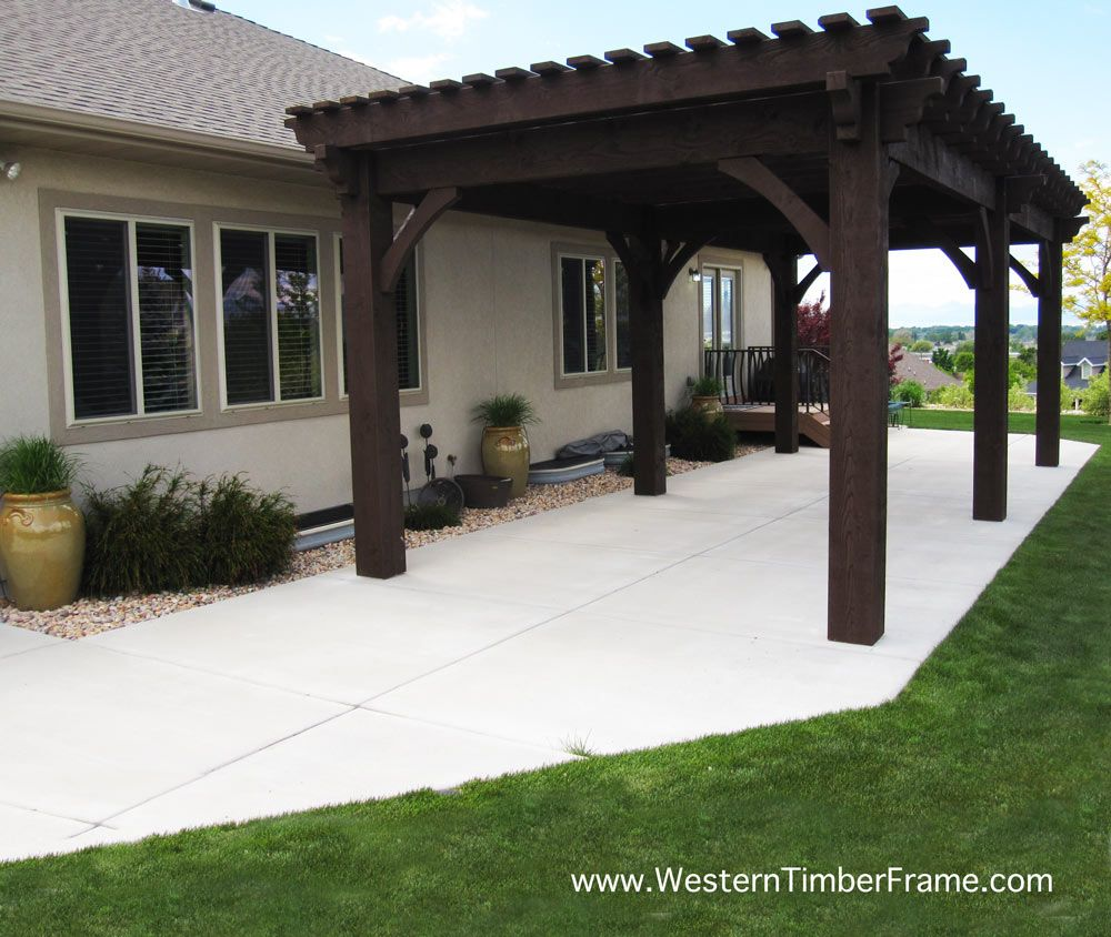 A 14x31 solid wood over sized timber frame pergola from Western Timber Frame  using old world post and beam dovetailed mortise and tenon joint system. - Pergola Kits (landing Page) Beautiful Backyard Shade Ideas