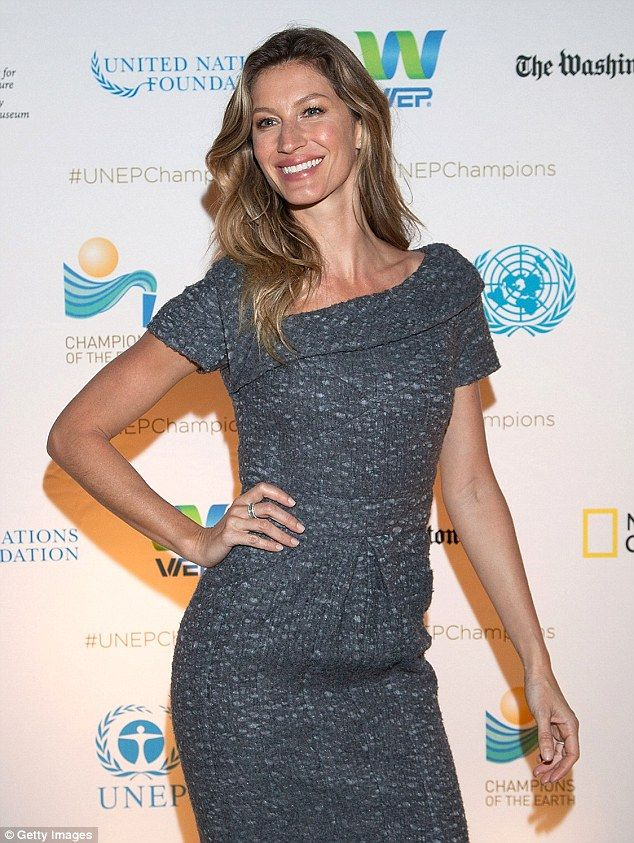 Gisele Bündchen stuns in demure grey dress at environmental affair #dailymail