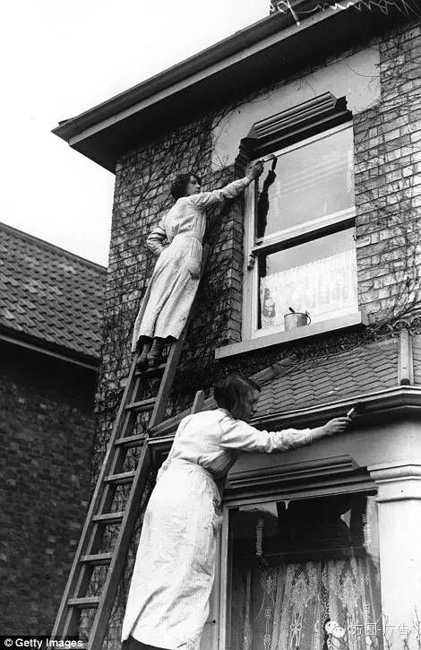 c1916 Woman painting houses in Kingston.