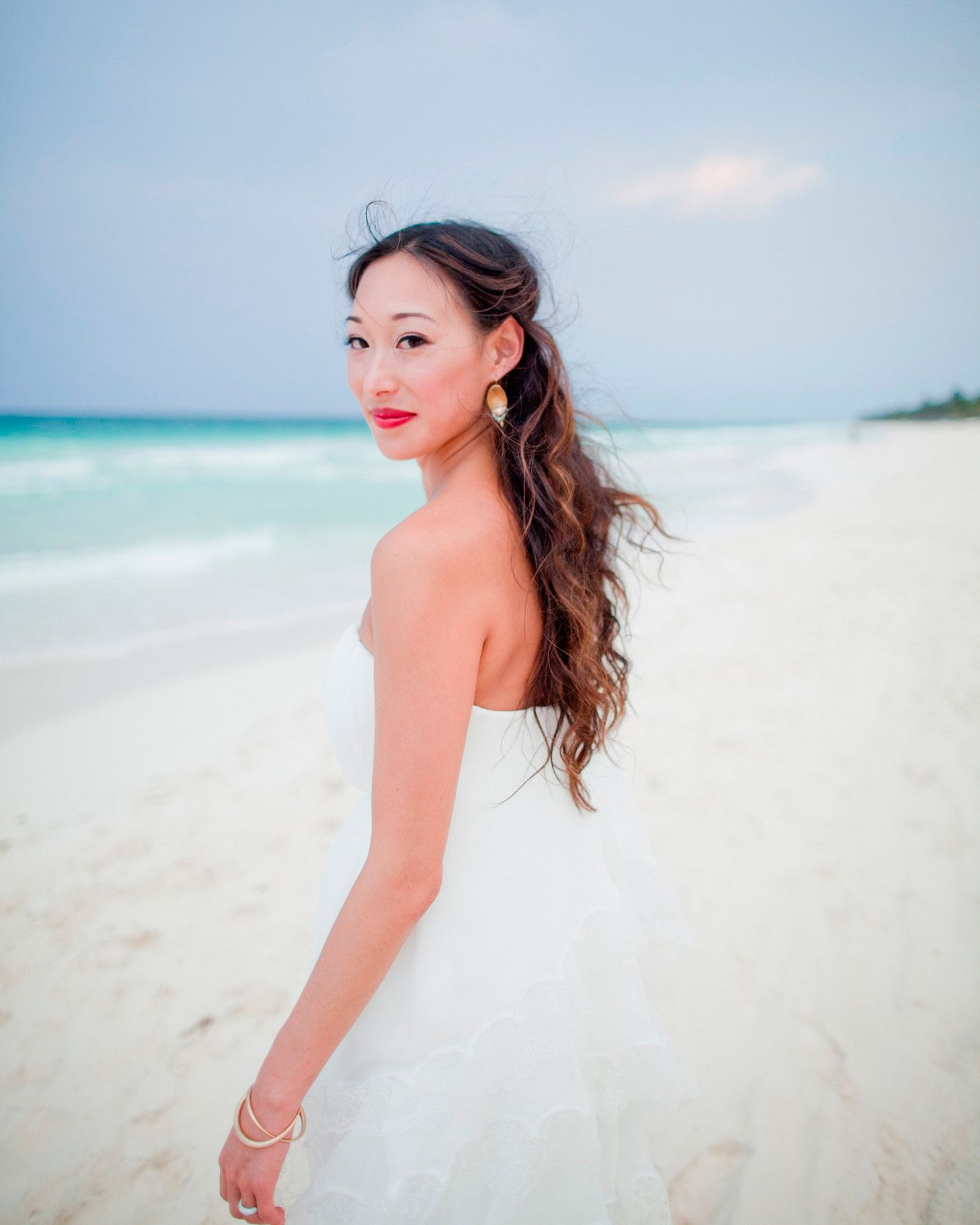 Relaxed beach wedding  Bright lipstick is one of Oliviaus everyday style signatures While