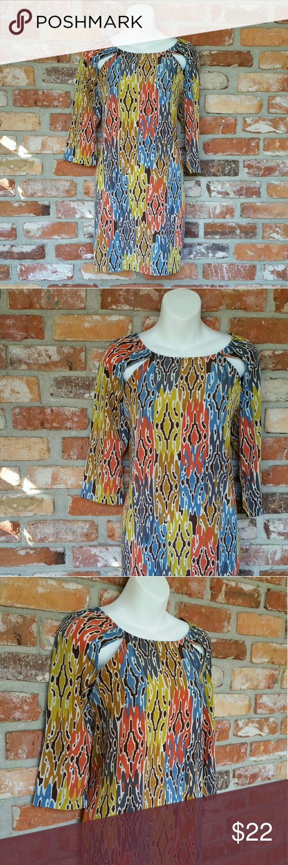{Glam Abstract Shift Dress} Style comes easy in this little shift dress. Beautiful warm colors and shoulder cut outs complete the look. Like new condition. Made in the USA.   Measurements  Bust: 39 inches  Length: 33 inches   Bundles and reasonable offers welcome. Glam Dresses