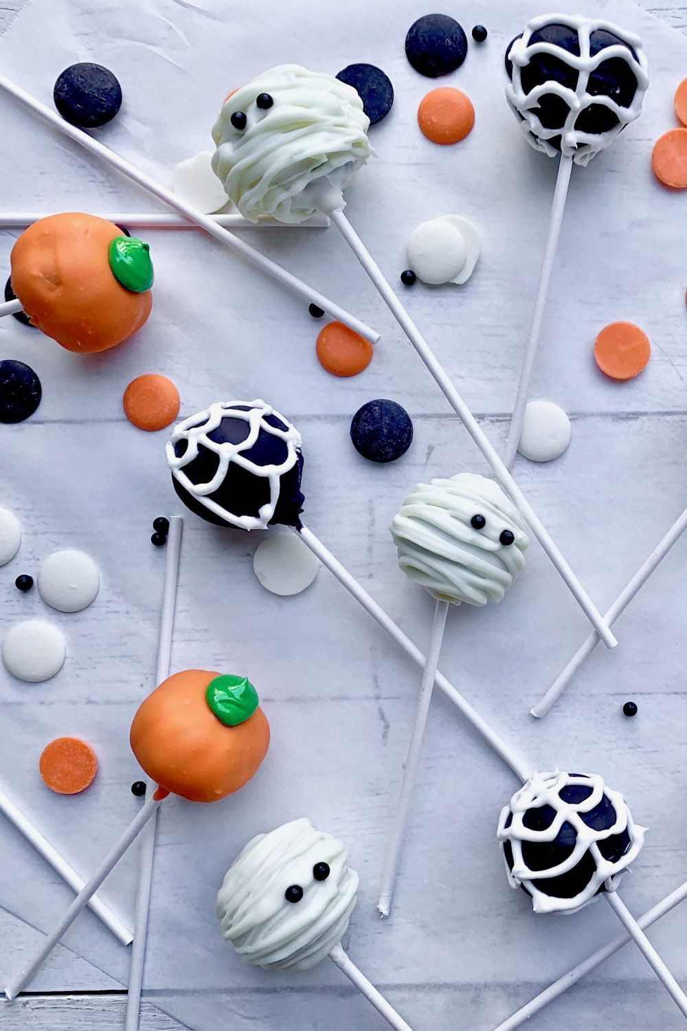 Decorative and cute, our Halloween Cake Pops are very simple to make, only requiring a little legwork for the decorating. Whether you pick up the mummy, the pumpkin, or the spider web cake pop, you can count on them being equally delicious and adorable. #halloweencakepops #pumpkin #cute #easy #ideas #southernliving