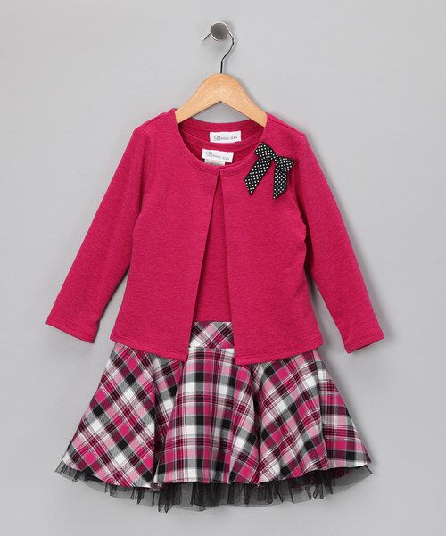 Let girls be girls in this number featuring a classic plaid pattern. Dress it up or down with tights and accessories. Every little girl deserves to own at least one dress that makes her feel fancy.Includes dress and cardiganCardigan and bodice: 96% polyester / 4% spandexSkirt: 65% polyester / 35% rayonLining: 100% polyesterNetting: 100% nylonMachine wash; hang dryMade in the Philippines